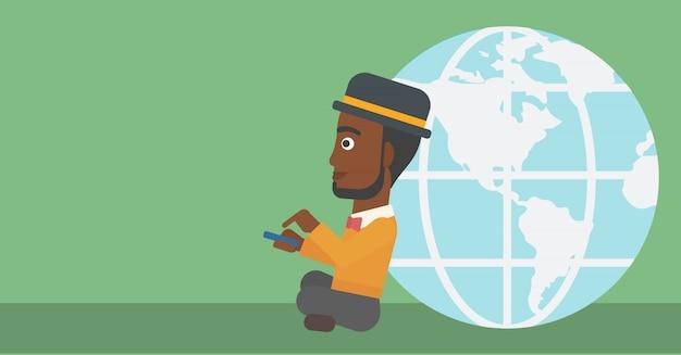 Uomo d'affari che si siede vicino al globo della terra. Vettore Premium