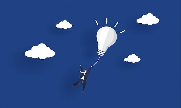 Uomo d'affari che vola fuori dalla lampadina dell'idea. illustrazione di concetto di ispirazione Vettore Premium