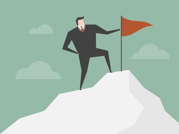 Uomo d'affari sulla cima di una montagna Vettore gratuito