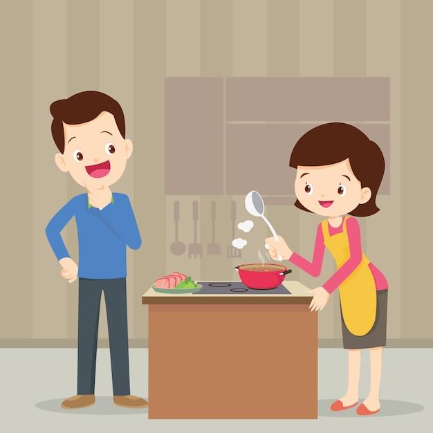 Uomo e donna in cucina Vettore Premium