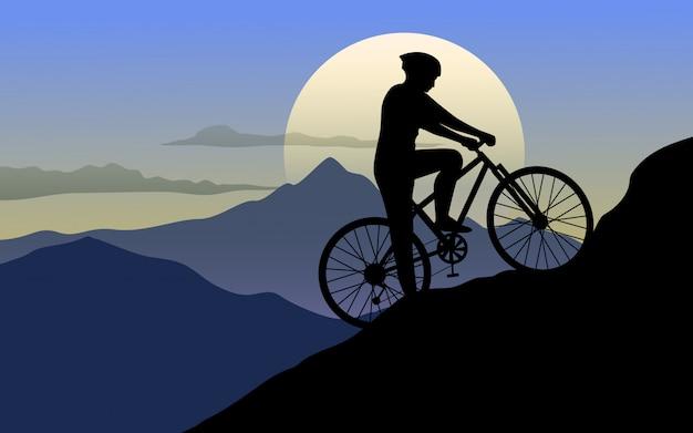 Uomo in bicicletta sulle colline al tramonto Vettore Premium