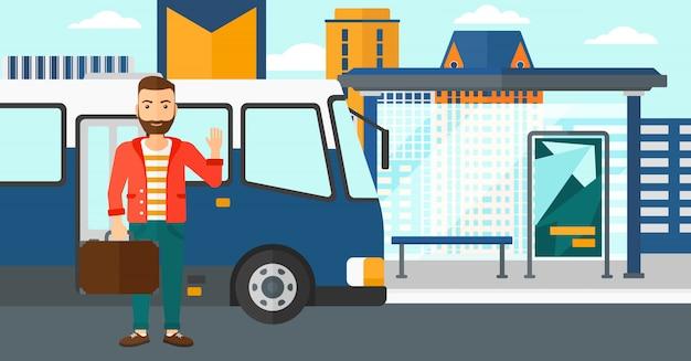 Uomo in piedi vicino al bus. Vettore Premium