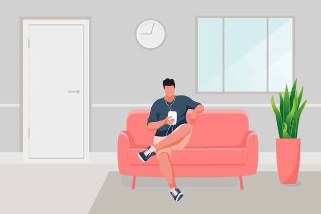 Uomo seduto sul divano Vettore Premium