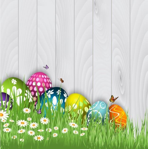 Uova di Pasqua con le farfalle Sfondo Vettore gratuito