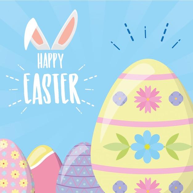 Uova di pasqua felici con i colori pastelli e la cartolina d'auguri delle orecchie di coniglio Vettore gratuito