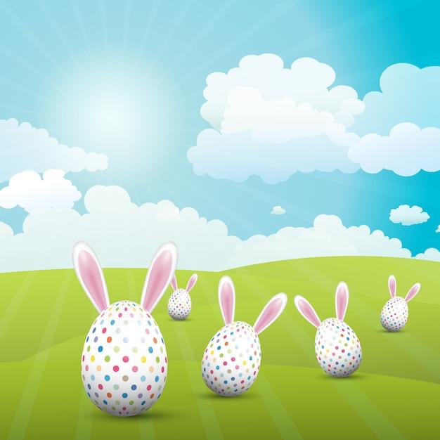 Uova di pasqua sveglie con le orecchie del coniglietto in un paesaggio soleggiato Vettore gratuito