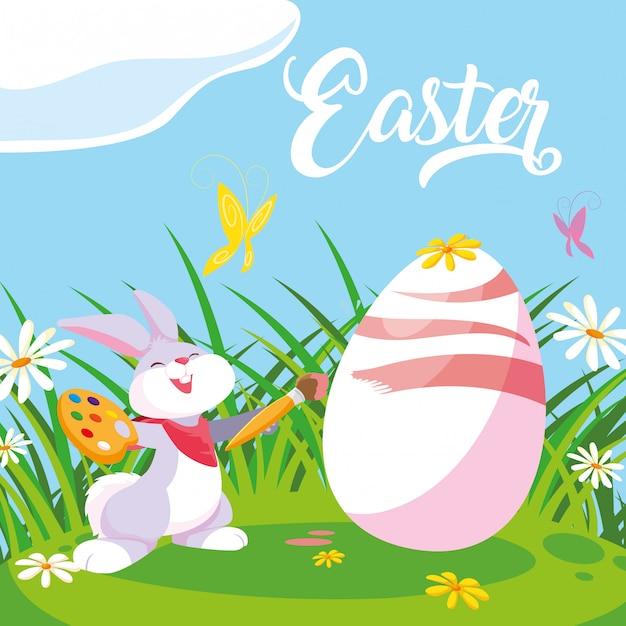 Uovo sveglio della pittura del coniglio di pasqua in giardino Vettore Premium