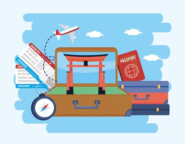 Valigetta con tokyo sculture e biglietti con passaporto Vettore Premium