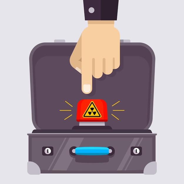 Valigia aperta con un pulsante nucleare rosso Vettore Premium