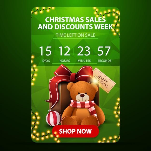 Vendite di natale e settimana di sconto, banner verticale verde con conto alla rovescia Vettore Premium