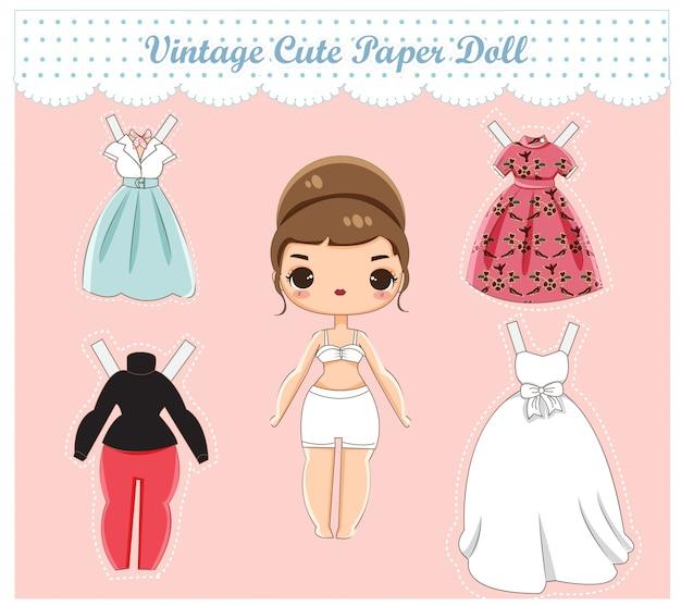 Vettore della bambola di carta vintage carino Vettore Premium