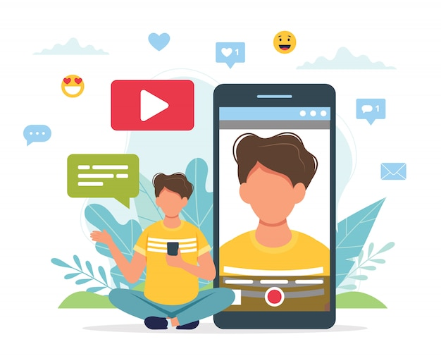 Video blogger che registra video con lo smartphone. Vettore Premium