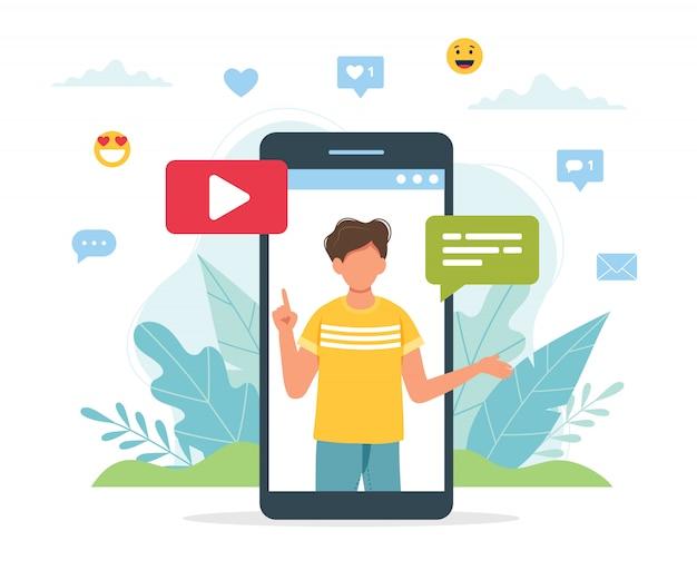 Video blogger maschio sullo schermo dello smartphone. Vettore Premium