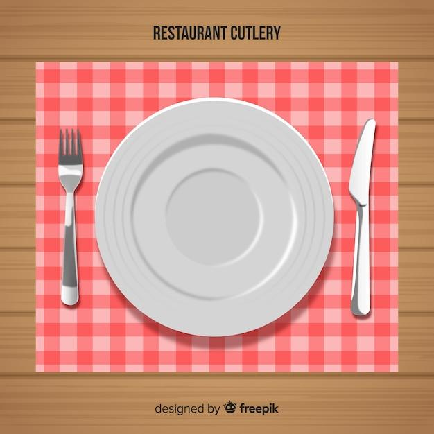 Vista dall'alto di posate ristorante con un design realistico Vettore gratuito