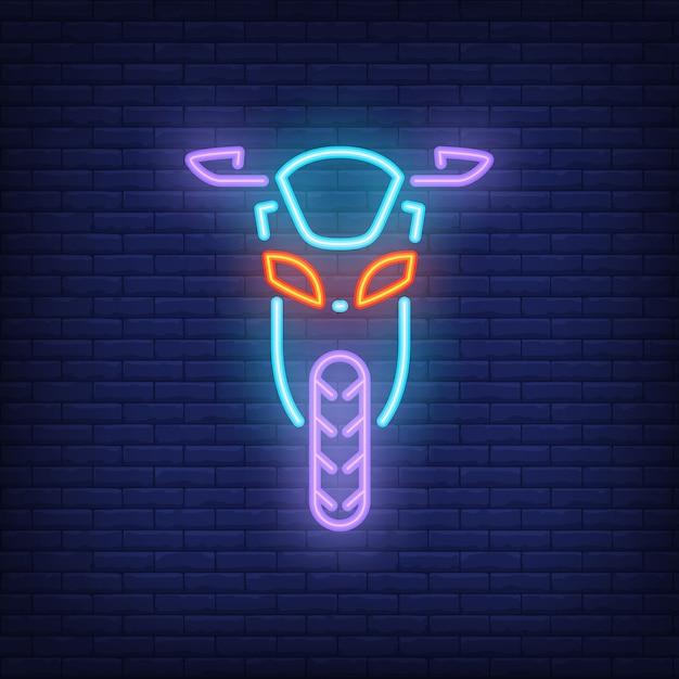 Vista frontale della moto su sfondo di mattoni. stile neon circolo dei motociclisti, garage Vettore gratuito