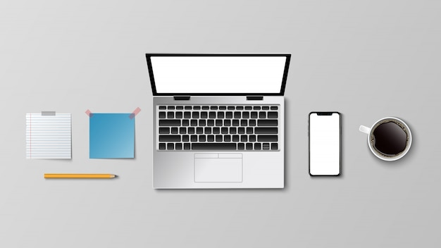 Vista superiore del posto di lavoro moderno, matita della nota della carta del caffè del computer portatile sul bianco Vettore Premium