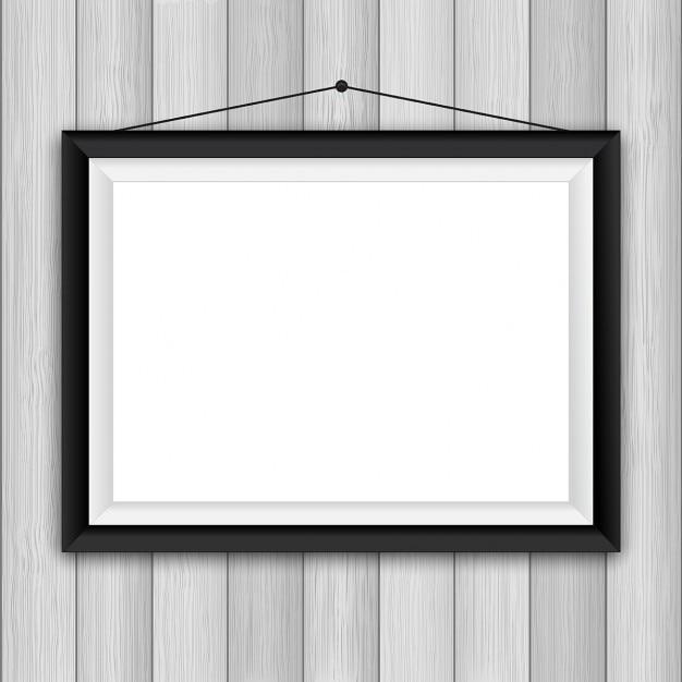 Vuoto cornice su uno sfondo parete in legno Vettore gratuito