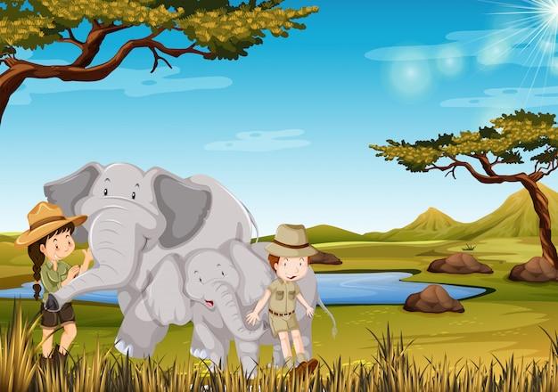 Zookeeper con elefante nello zoo Vettore gratuito