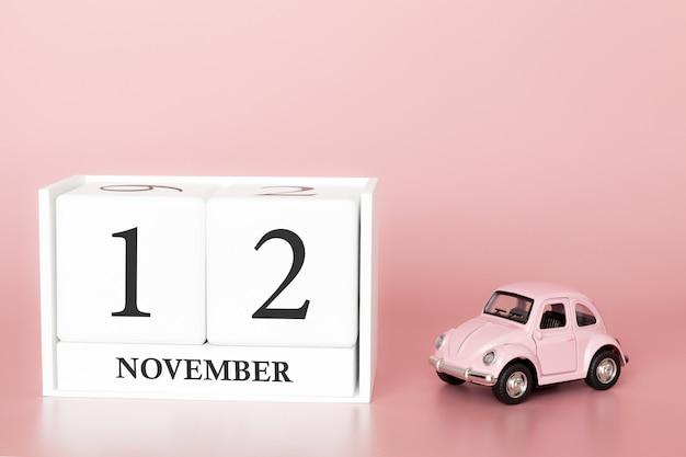 12 november. dag 12 van de maand. kalenderkubus met auto Premium Foto