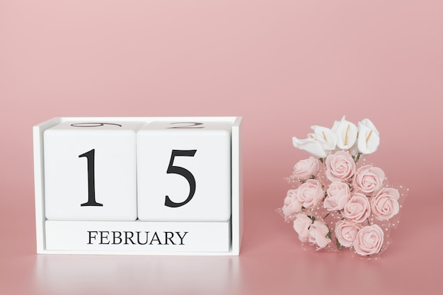 15 februari. dag 15 van de maand. kalenderkubus op moderne roze achtergrond, concept zaken en een belangrijke gebeurtenis. Premium Foto