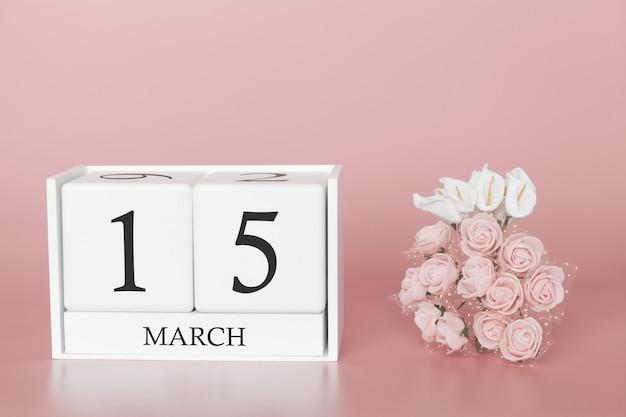 15 maart. dag 15 van de maand. kalenderkubus op modern roze Premium Foto
