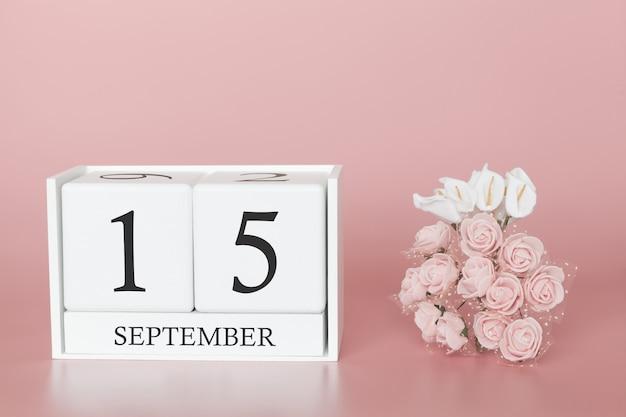 15 september. dag 15 van de maand. kalenderkubus op moderne roze achtergrond, concept zaken en een belangrijke gebeurtenis. Premium Foto