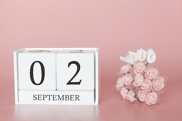 2 september. dag 2 van de maand. kalenderkubus op moderne roze achtergrond, concept zaken en een belangrijke gebeurtenis. Premium Foto
