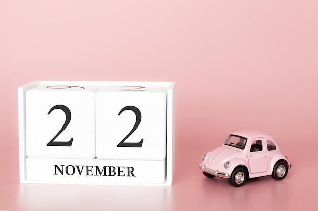 22 november. dag 22 van de maand. kalenderkubus met auto Premium Foto