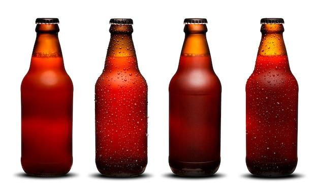 300ml bierflesjes met druppels en droogt op een witte achtergrond. ipa en bock. Premium Foto