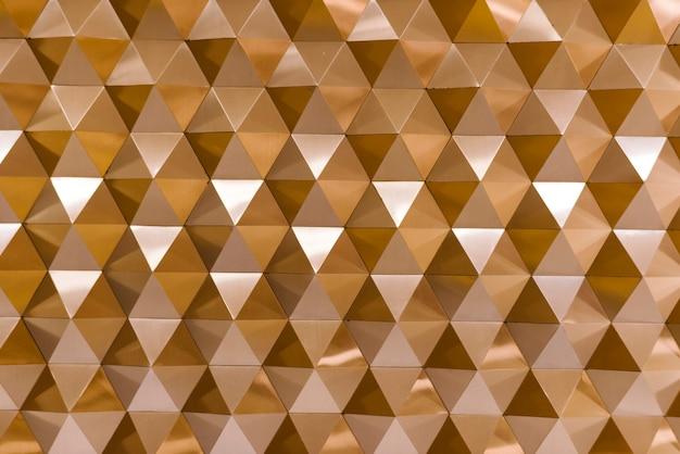 3d geometrische textuur in koper Gratis Foto