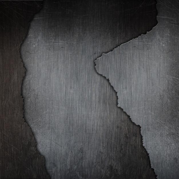 3d grunge gebarsten metalen textuur achtergrond Gratis Foto