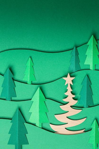 3d pop-out kerstbomen papier artwork op groen Premium Foto