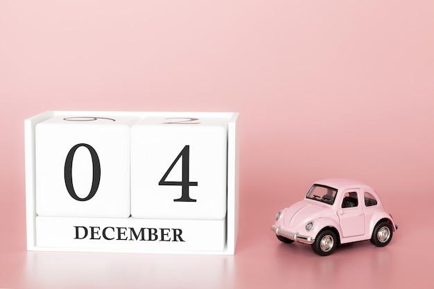 4 december. dag 4 van de maand. kalenderkubus met auto Premium Foto