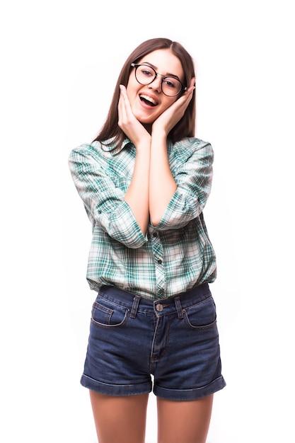 Aantrekkelijke verrast opgewonden glimlach tienermeisje, met witte tanden, over wit concept gelukkige student Gratis Foto