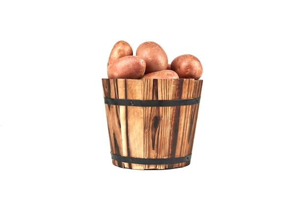 Aardappelen in een houten emmer. Gratis Foto