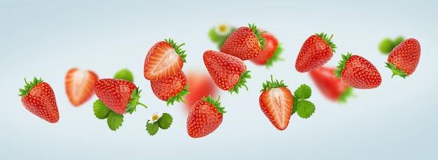 Aardbei op grijze achtergrond, dalende aardbeien wordt geïsoleerd die Premium Foto