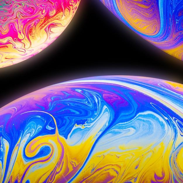 Abstracte achtergrond met blauwe gele en roze bollen Gratis Foto