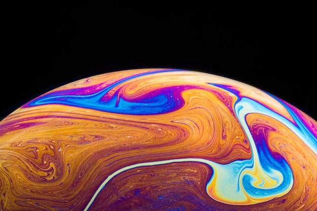 Abstracte achtergrond met fel oranje en paarse bol Gratis Foto