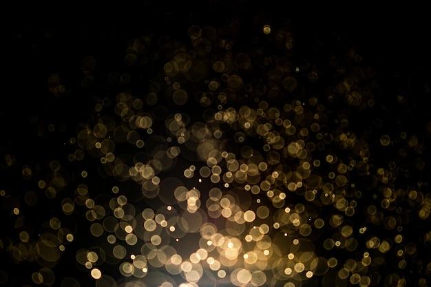 Abstracte achtergrond met gouden bokeh. goud glitter en elegant voor kerst achtergrond. Premium Foto