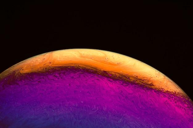 Abstracte achtergrond met paars en oranje bol Gratis Foto