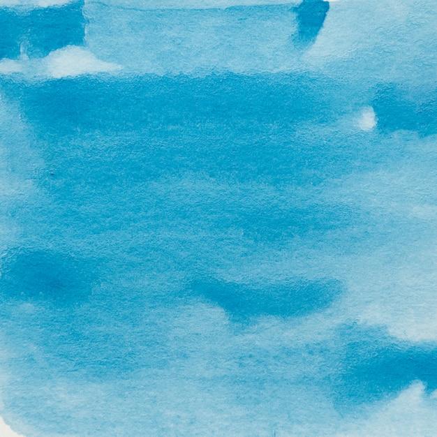 Abstracte achtergrond van blauwe waterverfverf Gratis Foto