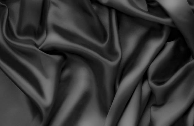 Abstracte achtergrondluxedoek of vloeibare golf of golvende vouwen Premium Foto
