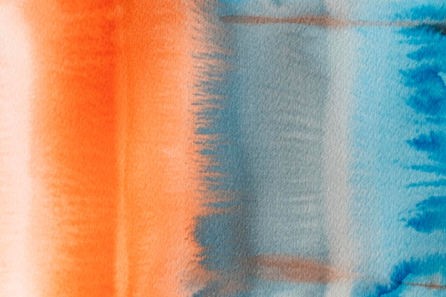 Abstracte aquarel oranje en blauwe achtergrond Gratis Foto
