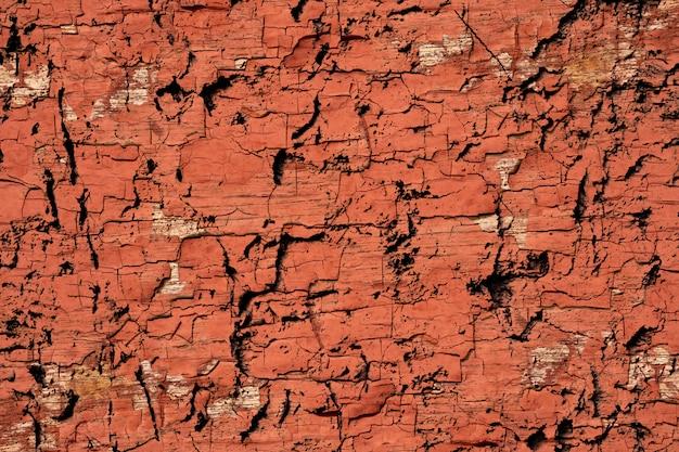 Abstracte gebarsten de textuurachtergrond van de grunge bruine en oranje verf muur Premium Foto