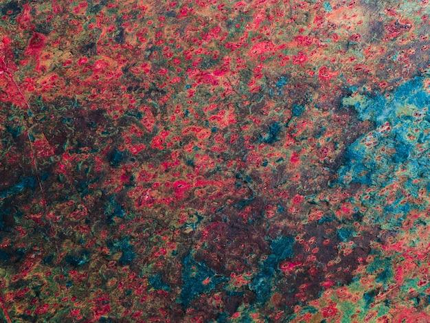 Abstracte gecorrodeerde kleurrijke roestige metalen oppervlak achtergrond. Premium Foto