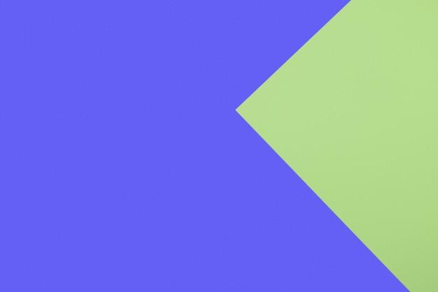 Abstracte geometrische achtergrond van lichtgroene en klassieke blauwe vellen aquarelpapier. Premium Foto