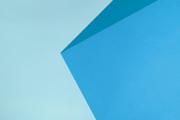 Abstracte geometrische document achtergrond in blauwe kleuren. Premium Foto