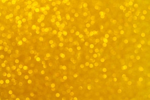 Abstracte gouden achtergrond. prachtig bokeh-effect. lichte cirkels achtergrond. Premium Foto