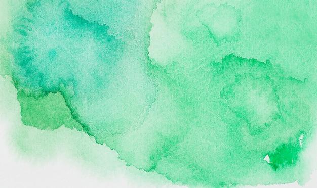 Abstracte groene vlekken van verven op wit papier Gratis Foto