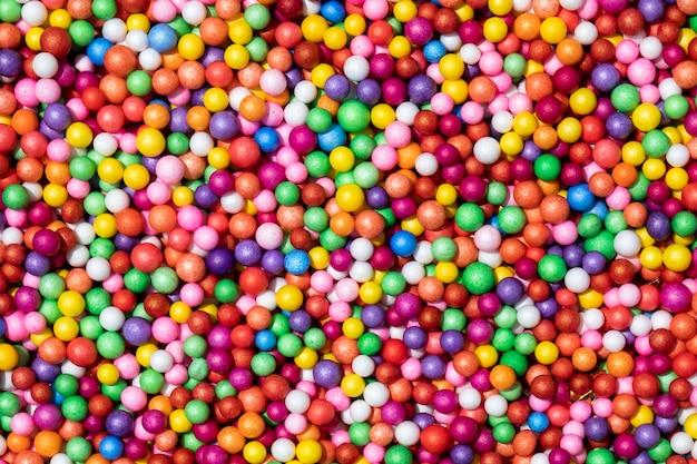Abstracte kleurrijk bestrooit achtergrondtextuur Premium Foto